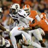 Photo -   South Carolina quarterback Dylan Thompson, center, scrambles out of the pocket away from Clemson's Travis Blanks (11) during the first half of an NCAA college football game on Saturday, Nov. 24, 2012, at Memorial Stadium in Clemson, S.C. (AP Photo/Richard Shiro)