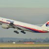 Photo - This photo provided by Laurent Errera taken Dec. 26, 2011, shows the Malaysia Airlines Boeing 777-200ER that disappeared from air traffic control screens Saturday, taking off from Roissy-Charles de Gaulle Airport in France. The Malaysia Airlines Boeing 777-200 carrying 239 people lost contact with air traffic control early Saturday morning, March 8, 2014 on a flight from Kuala Lumpur to Beijing, and international aviation authorities still hadn't located the jetliner several hours later. (AP Photo/Laurent Errera)
