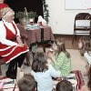 Photo - Mrs. Claus (Donna Cocoma) reading stories and talking to children while they drink hot chocolate at Santa's Art Workshop at the Edmond Fine Arts Instsitute. Photo by Steven N. Maupin, for The Oklahoman