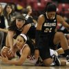 Photo - Wake Forest's Kelila Atkinson, right, and Millesa Calicott, behind, and Maryland's Chloe Pavlech, bottom, reach for a loose ball in the second half of an NCAA college basketball game on Thursday, Jan 9, 2014, in College Park, Md. Maryland won 76-49. (AP Photo/Gail Burton)