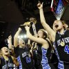 Photo - From left, Deer Creek's Elanya Wilson (22), Whiney Jones (13), Bayli Blanchard (32) and Glenn Chesley (41) celebrate with the gold ball trophy after the Class 5A girls championship game in the state high school basketball tournament between Deer Creek and Tulsa East Central at the Mabee Center in Tulsa, Okla., Saturday, March 15, 2014. Deer Creek won, 31-28. Photo by Nate Billings, The Oklahoman