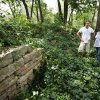 Dan Riedemann, left, owner of 19th Century Restorations, and Brenda Duke on the property where the Woody Guthrie