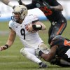 Oklahoma State\'s Tyler Johnson (40) brings down Purdue\'s Robert Marve (9) during the Heart of Dallas Bowl football game between Oklahoma State University and Purdue University at the Cotton Bowl in Dallas, Tuesday, Jan. 1, 2013. Oklahoma State won 58-14. Photo by Bryan Terry, The Oklahoman