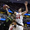 Photo - Baylor guard Gary Franklin (4) has a shot stopped by Wisconsin forward Frank Kaminsky (44) during an NCAA men's college basketball tournament regional semifinal, Thursday, March 27, 2014, in Anaheim, Calif. (AP Photo/Mark J. Terrill)