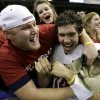 UNIVERSITY OF OKLAHOMA / OU / COLLEGE FOOTBALL / BIG 12 CHAMPIONSHIP: An unidentified fan grabs Oklahoma quarterback Sam Bradford, right, after beating No. 1 Missouri 38-17 in the Big 12 Conference championship football game, Saturday, Dec. 1, 2007, in San Antonio. (AP Photo/Matt Slocum) ORG XMIT: SAD120
