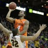Oklahoma\'s Brian Williams (4) shoots over Missouri\'s Steve Moore (32) during the Big 12 tournament men\'s basketball game between the Oklahoma State Cowboys and Missouri Tigers the Sprint Center, Thursday, March 8, 2012 Photo by Sarah Phipps, The Oklahoman