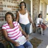 Three sisters, Cleta Jennings, Antwun Parker\'s mother, Sharon Jennings, Antwun\'s aunt, and Sheila Osborn, Antwun\'s aunt, on Sharon\'s front porch talking about Antwun in Oklahoma City Friday, May 29, 2009. Photo by Paul B. Southerland, The Oklahoman