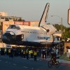 Space Shuttle Endeavour makes it\'s way down Manchester Blvd in Inglewood, Calif., Saturday, Oct. 13, 2012. The Endeavour\'s terrestrial journey began before dawn Friday when it departed from the Los Angeles International Airport, rolling on a 160-wheeled carrier past diamond-shaped