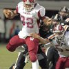 Wynnewood\'s Trey Knowles (32) drags a tackler as the Wayne Bulldogs play the Wynnewood Savages in District 5, Class A high school football on Friday, Oct. 28, 2011, in Wayne, Okla. Photo by Steve Sisney, The Oklahoman