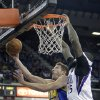 Photo - Golden State Warriors forward David Lee, left, goes to the basket against Sacramento Kings center DeMarcus Cousins during the first quarter of an NBA basketball game in Sacramento, Calif., Sunday, Dec. 1, 2013. (AP Photo/Rich Pedroncelli)