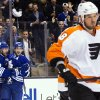 Toronto Maple Leafs\' Clarke MacArthur, center, celebrates his goal with Michael Kostka (53) as Philadelphia Flyers\' Nicklas Grossman skates by during the second period of their NHL hockey game, Monday, Feb. 11, 2013, in Toronto. (AP Photo/The Canadian Press, Chris Young)