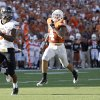 Oklahoma State\'s Jeremy Smith (31) runs in for a touchdown as Texas\' Kenny Vaccaro (4) and Carrington Byndom (23) chase him down during second half of a college football game between the Oklahoma State University Cowboys (OSU) and the University of Texas Longhorns (UT) at Darrell K Royal-Texas Memorial Stadium in Austin, Texas, Saturday, Oct. 15, 2011. Photo by Sarah Phipps, The Oklahoman