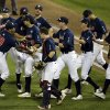 Photo - Vanderbilt players celebrate after Vanderbilt defeated Virginia 9-8 in the opening game of the best-of-three NCAA baseball College World Series finals in Omaha, Neb., Monday, June 23, 2014. (AP Photo/Nati Harnik)