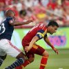 Photo - Real Salt Lake midfielder Javier Morales, right, tries to hang onto the ball as New England Revolution defender Jose Goncalves, left, pursues in the first half of an MLS soccer match on Friday, July 4, 2014, in Sandy, Utah. (AP Photo/Kim Raff)
