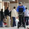 Midwest City Police Sgt. Joel Warner patrols Town Center Plaza on a Segway Friday morning. Nov. 28, 2008. Police Lt. Matt Dukes said an officer on the Segway will be patrolling the shopping center, located on SE 29 east of Air Depot, every day through Dec. 24. Dukes estimated 750 shoppers were in line outside the major retail stores in the center before stores opened their doors. He said,