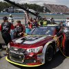 Photo - Crew members work on Jeff Gordon's car behind the pit wall during a NASCAR Sprint Cup Series auto race at Watkins Glen International, Sunday, Aug. 10, 2014, in Watkins Glen N.Y. (AP Photo/Mel Evans)