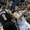 Minnesota Timberwolves\' Ricky Rubio, right, of Spain, lays up past Brooklyn Nets\' Deron Williams in the first half of an NBA basketball game on Wednesday, Jan. 23, 2013, in Minneapolis. (AP Photo/Jim Mone)