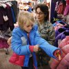 USAF Colonel Francesca Bartholomew, helps six year-old Park View Elementary first grader Dakota Leavens try on a new coat. More than 35 Department of Defense employees at Tinker Air Force Base teamed with students from various Mid-Del elementary schools Thursday morning, Dec. 5, 2013, on a storewide shopping spree at JC Penney store in Town Center Plaza on SE 29 Street in Midwest City. Photo by Jim Beckel, The Oklahoman