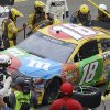 Photo - Kyle Busch has his car worked on in the pits after an accident during the NASCAR Sprint Cup series auto race on Sunday, June 23, 2013, in Sonoma, Calif. (AP Photo/Ben Margot)