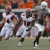 Oklahoma State\'s Joseph Randle runs up field as Louisiana-Lafayette\'s Justin Anderson, left, and Brandon Johnson chase him down during their game Saturday. Photo by Sarah Phipps, The Oklahoman