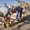 Pastor Rick Stansberry, left, joins his parishioners from Christ the King Catholic Church in volunteering labor to build this Habitat for Humanity house in the Hope Crossing neighborhood near Britton and Kelley Avenue on Saturday, Sep. 22, 2012. The parish has donated $80,000 toward a new central Oklahoma Habitat for Humanity Home to celebrate the church\'s 50th anniversary in their current building in Nichols Hills. This home is being built in the 600 block of NE 85th Street. Photo by Jim Beckel, The Oklahoman.