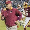 Photo - Washington Redskins head coach Joe Gibbs runs off the field with his team after they defeated the Philadelphia Eagles 20-12 in a NFL football game Monday, Sept. 17, 2007, in Philadelphia. (AP Photo/Tom Mihalek) ORG XMIT: PATM108