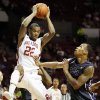 Oklahoma\'s Amath M\'Baye (22) catches a pass next to TCU\'s Garlon Green (33) during an NCAA men\'s basketball game between the University of Oklahoma (OU) and Texas Christian University (TCU) at the Lloyd Noble Center in Norman, Okla., Monday, Feb. 11, 2013. Photo by Nate Billings, The Oklahoman