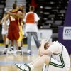 Ross Morrisett of Edmond Santa Fe sits on the ground as Putnam City North celebrates their win in the class 6A boys state basketball semifinal at the Ford Center in Oklahoma City, Friday March 7, 2008. BY BRYAN TERRY, THE OKLAHOMAN