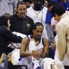 Photo - INJURY / INJURED: ** ADVANCE FOR WEEKEND EDITIONS, MARCH 28-29 -- FILE -- ** In this Feb. 26, 2007 file photo, Los Angeles Clippers' Shaun Livingston sits on a stretcher after injuring his knee during the first quarter of an NBA basketball game against the Charlotte Bobcats in Los Angeles.  Livingston was down and out after shredding his knee when he landed after a layup attempt in a Feb. 26, 2007, game. He had gone from being the No. 4 overall pick straight out of a Peoria, Ill., high school to contributing to a rare Los Angeles Clippers playoff run to suddenly needing to learn to walk again. (AP Photo/Chris Pizzello, File) ORG XMIT: NY181