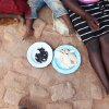 In this photo taken Monday Jan. 7, 2013, members of the Nkomo family eat a meal of mopane worms and cooked maize meal outside their home in Gwanda, Zimbabwe. In Zimbabwe as well as most parts of southern Africa, mopane worms are a staple part of the diet in rural areas and are considered a delicacy in the cities. They can be eaten dry, as crunchy as potato chips, or cooked and drenched in sauce. (AP Photo/Tsvangirayi Mukwazhi)