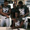 Michigan State\'s Shilique Calhoun (89) is interviewed by teammate Kurtis Drummond (27) as Joel Heath, center, and R.J. Williamson (26) tease him during the team\'s NCAA college football media day, Monday, Aug. 4, 2014, in East Lansing, Mich. (AP Photo/Al Goldis)