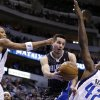 Photo - Dallas Mavericks' Shawn Marion, left, and Elton Brand (42) defend as Orlando Magic's J.J. Redick makes a pass beneath the basket during the first half of an NBA basketball game Wednesday, Feb. 20, 2013, in Dallas. (AP Photo/Tony Gutierrez)