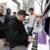 This photo taken on Dec. 7, 2012 shows Justin Niederhauser, 19, from Boise, Idaho, as he plays the piano on the 16th Street Mall in downtown Denver. A ride through downtown\'s 16th Street Mall on the free bus shuttle is a ride through Denver\'s past and current scene. (AP Photo/Ed Andrieski)