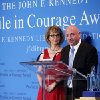 Photo - Former Arizona congresswoman Gabrielle Giffords, left, listens as her husband Capt. Mark Kelly speaks after Giffords received the John F. Kennedy Profile in Courage Award at the JFK Library in Boston, Sunday, May 5, 2013.  (AP Photo/Michael Dwyer)
