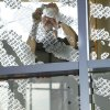 Artist Alan Saucier removes masking material from a window, as new etched glass murals in the form of fingerprints are created on the windows of the Forensic Science Building on the campus of the University of Central Oklahoma in Edmond, OK, Tuesday, June 14, 2011. By Paul Hellstern, The Oklahoman