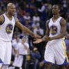 Golden State Warriors\' Jarrett Jack, left, and Harrison Barnes (40) celebrate during a timeout in the second half of an NBA basketball game against the Oklahoma City Thunder Wednesday, Jan. 23, 2013, in Oakland, Calif. (AP Photo/Ben Margot)
