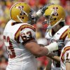 FILE - In this Sept. 15, 2007, file photo, Iowa State kicker Bret Culbertson, right, celebrates with teammate Ben Lamaak after making a field goal during the first half of a college football game against Iowa in Ames, Iowa. With uneven testing for steroids and inconsistent punishment, college football players are packing on significant weight _ in some cases, 30 pounds or more in a single year _ without drawing much attention from their schools or the NCAA in a sport that earns tens of billions of dollars for teams. Lamaak, who arrived at Iowa State in 2006, said he weighed 225 pounds in high school and 262 pounds in the summer of his freshman year on the Cyclones football team. A year later, official rosters showed the former basketball player from Cedar Rapids weighed 306, a gain of 81 pounds since high school. He graduated as a 320-pound offensive lineman and said he did it all naturally.