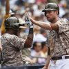 San Diego Padres\' Chase Headley high fives his way into the dugout after scoring on a double by Cameron Maybin during the fourth inning of a baseball game Sunday, June 29, 2014, in San Diego. (AP Photo/Lenny Ignelzi)