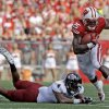 Photo - Wisconsin's Melvin Gordon, right, breaks away from Massachusetts's Randall Jette (4) during the first half of an NCAA college football game Saturday, Aug. 31, 2013, in Madison, Wis. (AP Photo/Morry Gash)