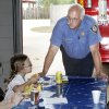 Katy Hurst, 7, from Horace Mann Elementary School, talks to Lt. Edward Koch, as the fire crew at station 11 holds a cookout for students at Horace Mann Elementary and Putnam Heights Elementery who participated in a reading program with the firefighters in Oklahoma City, OK, Monday, May 17, 2010. By Paul Hellstern, The Oklahoman