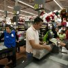 Photo - A man pays at the cash register at a Walmart Superstore in Mexico City. U.S. lawmakers are making public emails that show Walmart Stores Inc.'s CEO found out in 2005 that the retailer was handing out bribes in Mexico. AP Photo