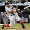 Photo - Boston Red Sox's Mike Napoli hits an RBI-single during the fifth inning of a baseball game against the New York Yankees, Thursday, Sept. 5, 2013, at Yankee Stadium in New York. (AP Photo/Bill Kostroun)