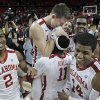 Cade Davis (34) is lifted by teammate Calvin Newell Jr. (11) after the game as the University of Oklahoma Sooner (OU) men\'s basketball team defeats the Oklahoma State University Cowboys (OSU) 64-61 at the Lloyd Noble Center on Saturday, March 5, 2011, in Norman, Okla. Photo by Steve Sisney, The Oklahoman ORG XMIT: KOD