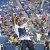 Photo - Marin Cilic, of Croatia, reacts after defeating Gilles Simon, of France, in five sets during the fourth round of the 2014 U.S. Open tennis tournament, Tuesday, Sept. 2, 2014, in New York. (AP Photo/John Minchillo)