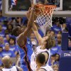 Oklahoma City\'s Kevin Durant (35) dunks the ball over Dallas\' Dirk Nowitzki (41) during Game 3 of the first round in the NBA playoffs between the Oklahoma City Thunder and the Dallas Mavericks at American Airlines Center in Dallas, Thursday, May 3, 2012. Oklahoma City won 95-79. Photo by Bryan Terry, The Oklahoman
