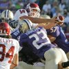 OU quarterback Sam Bradford (14) extends the ball over the pile for a rushing touchdown in the second quarter during the college football game between Oklahoma and Washington at Husky Stadium in Seattle, Wash., Saturday, September 13, 2008. BY NATE BILLINGS, THE OKLAHOMAN