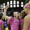 Photo - Washington's Mercedes Wetmore  (1) leads teammates in celebrating after they defeated Stanford in an NCAA women's basketball game, Sunday, Feb. 9, 2014, in Seattle. Washington upset Stanford 87-82. (AP Photo/Elaine Thompson)