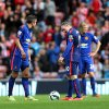 Photo - Manchester United's captain Wayne Rooney, right, and Robin Van Persie, left, stand dejected after Sunderland's Jack Rodwell scores his goal during their English Premier League soccer match at the Stadium of Light, Sunderland, England, Sunday, Aug. 24, 2014. (AP Photo/Scott Heppell)