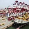 FILE - In this Friday Sept. 2, 2011, file photo, a freighter is docked at the container terminal at a port in Qingdao, in east China\'s Shandong province. Cheap imports of goods from China have benefited American consumers and helped keep inflation down. But those imports have hurt American manufacturers, and many U.S.-based companies outsource production to China to cut costs, which has also caused U.S. job losses. One study estimated that between 2001 and 2010, 2.8 million U.S. jobs were lost or displaced to China, the world\'s second largest economy. (AP Photo) CHINA OUT