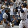 Photo - New York Yankees' Alex Rodriguez, right, gestures after hitting a second-inning solo home run in a baseball game against the Detroit Tigers, Sunday, Aug. 11, 2013, in New York. (AP Photo/Kathy Willens)